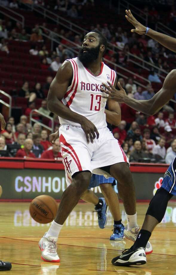 Houston Rockets shooting guard James Harden passes the ball behind his back against during the first quarter of NBA preseason game action against the Orlando Magic at the Toyota Center Wednesday, Oct. 16, 2013, in Houston.  ( James Nielsen / Houston Chronicle ) Photo: James Nielsen, Houston Chronicle