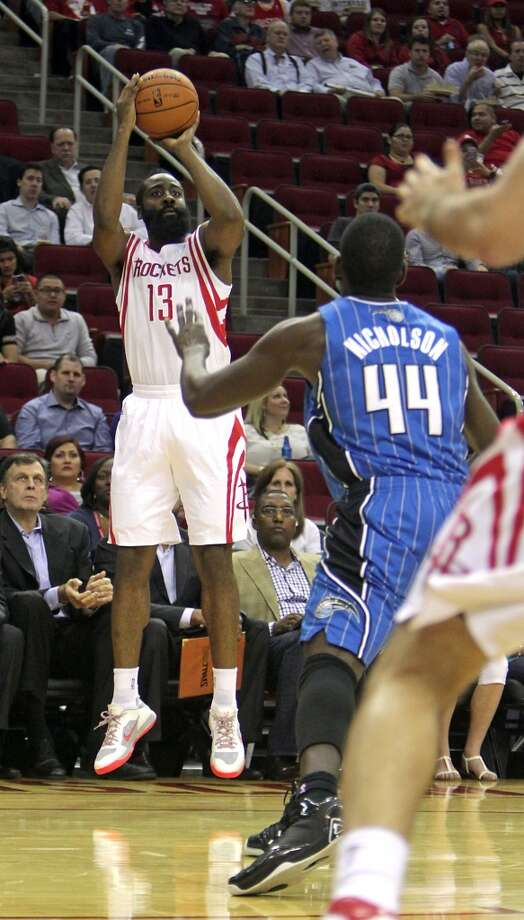 Houston Rockets shooting guard James Harden left, shoots the ball over Orlando Magic power forward Andrew Nicholson during the first quarter of NBA preseason game action at the Toyota Center Wednesday, Oct. 16, 2013, in Houston.  ( James Nielsen / Houston Chronicle ) Photo: James Nielsen, Houston Chronicle