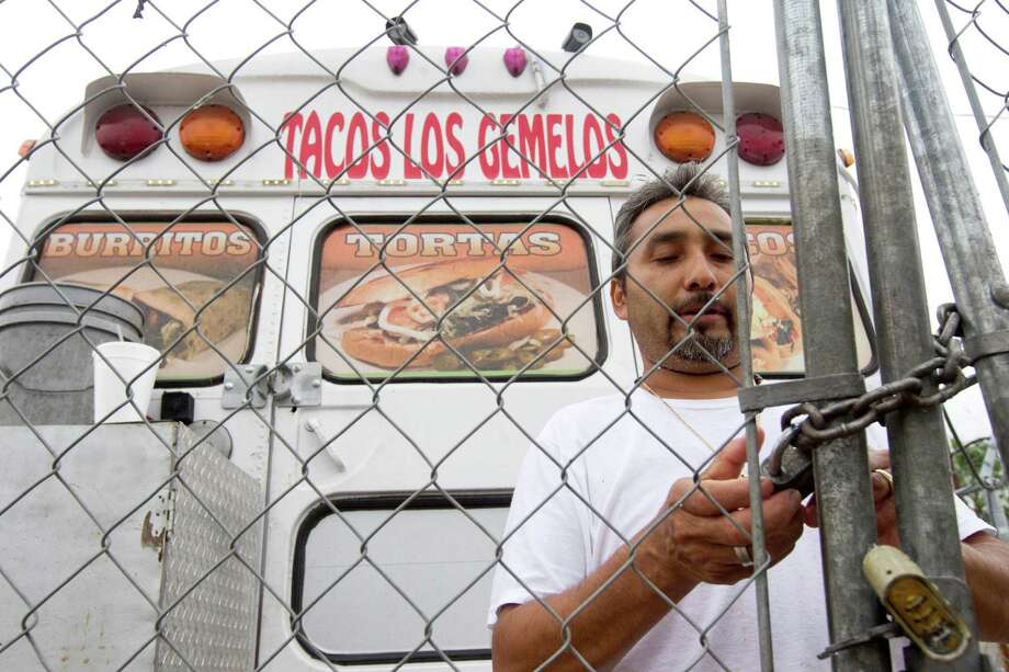 Francisco Garcia's business, Tacos Los Gemelos, is one of the area taco trucks victimized by robbers in recent weeks. Photo: Marie D. De Jeséºs, Staff / © 2013 Houston Chronicle