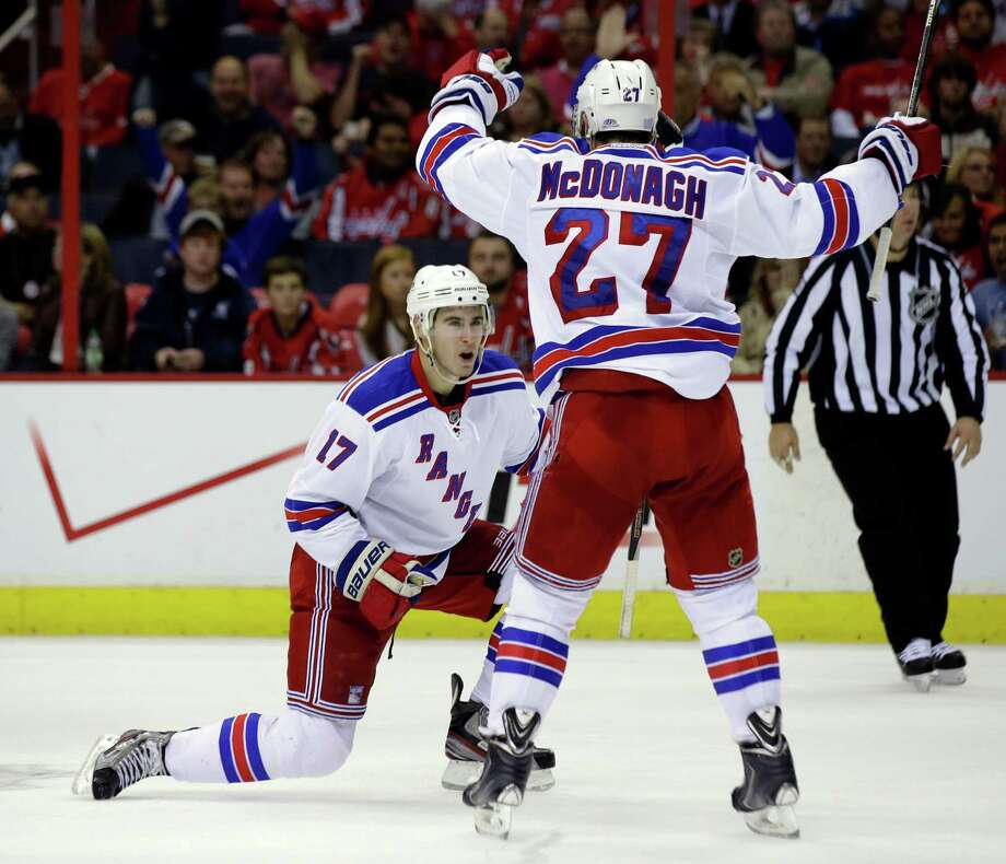 New York Rangers defenseman John Moore (17) celebrates his goal with defenseman Ryan McDonagh in the second period of an NHL hockey game against the Washington Capitals, Wednesday, Oct. 16, 2013, in Washington. (AP Photo/Alex Brandon) ORG XMIT: VZN106 Photo: Alex Brandon / AP