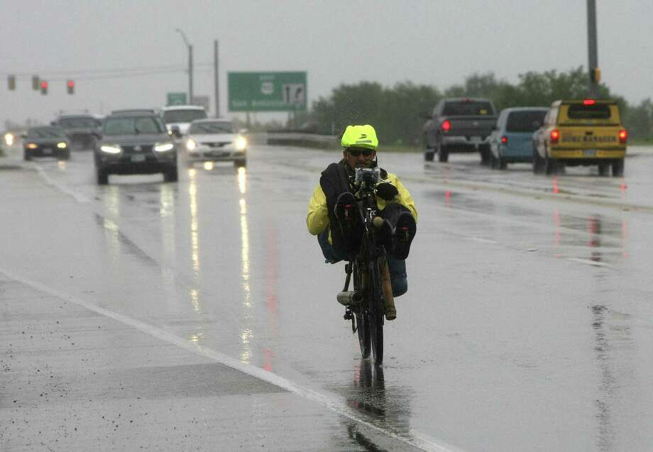 Dug Shelby rides his recumbent bicycle, custom-made in Brazil, on his way across the country. He passed through San Antonio before stopping in Kyle for the evening. Photo: Helen L. Montoya / San Antonio Express-News