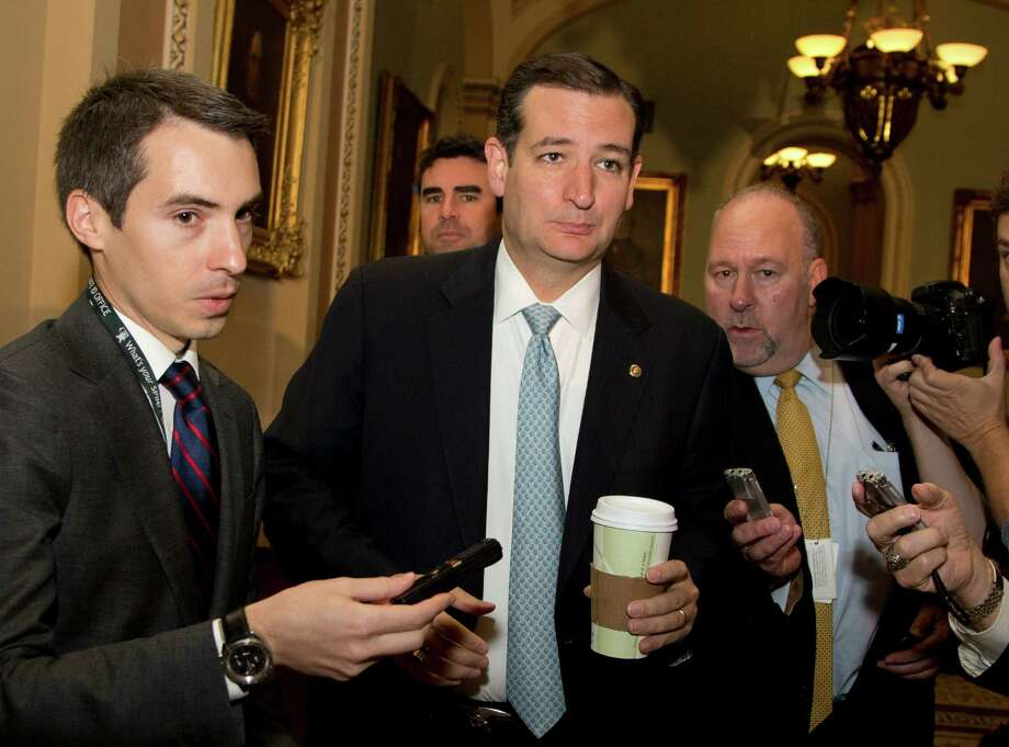 Sen. Ted Cruz, R-Texas,  is followed by reporters on Capitol Hill, Wednesday, Oct. 16, 2013, in Washington. Time is growing short for Congress to prevent a threatened Treasury default and stop a partial government shutdown. (AP Photo/Carolyn Kaster) ORG XMIT: DCCK106 Photo: Carolyn Kaster / AP