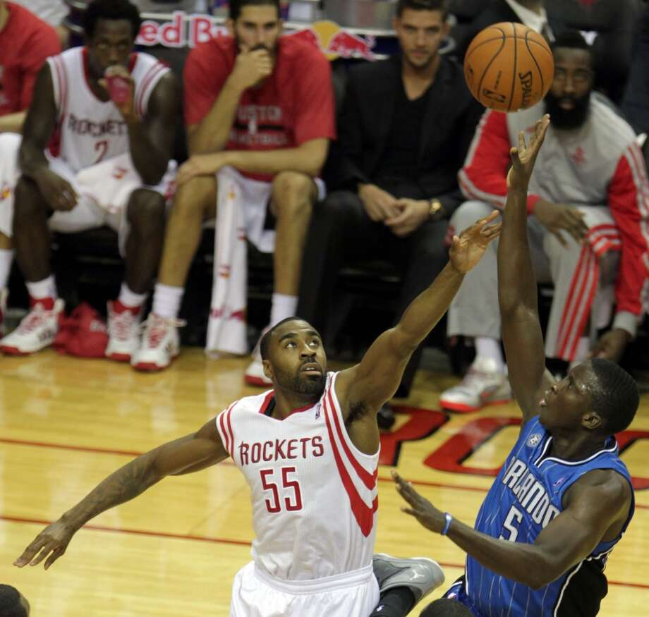 Orlando Magic shooting guard Victor Oladipo right, shoots the ball over Houston Rockets shooting guard Reggie Williams left, during the third quarter of NBA preseason game action at the Toyota Center Wednesday, Oct. 16, 2013, in Houston.  ( James Nielsen / Houston Chronicle ) Photo: Houston Chronicle