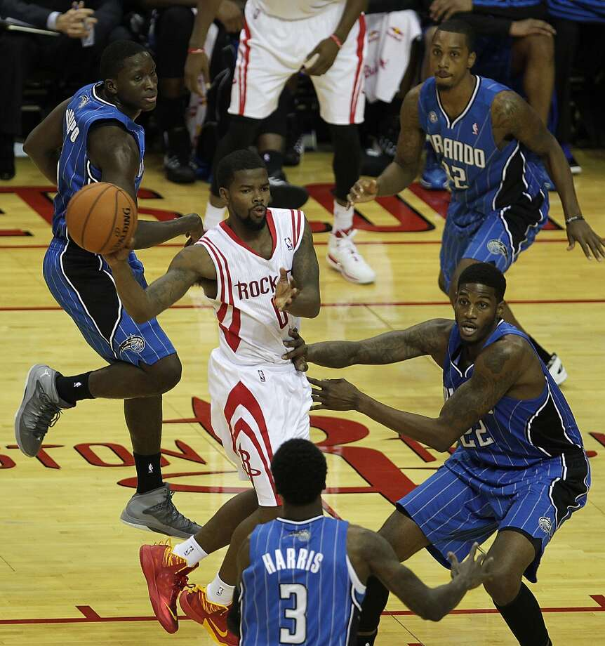Houston Rockets point guard Aaron Brooks center, passes the ball out against the Orlando Magic during the fourth quarter of NBA preseason game action at the Toyota Center Wednesday, Oct. 16, 2013, in Houston.  ( James Nielsen / Houston Chronicle ) Photo: Houston Chronicle