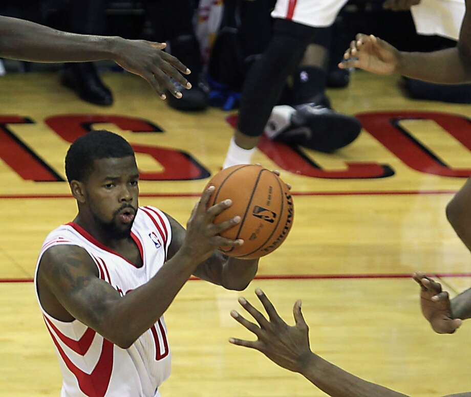 Houston Rockets point guard Aaron Brooks passes the ball during the fourth quarter of NBA preseason game action against the Orlando Magic at the Toyota Center Wednesday, Oct. 16, 2013, in Houston.  ( James Nielsen / Houston Chronicle ) Photo: Houston Chronicle