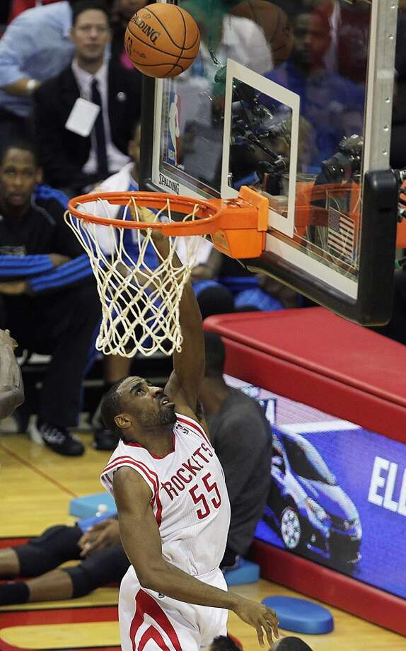 Houston Rockets shooting guard Reggie Williams watches his shot fall in the basket during the fourth quarter of NBA preseason game action against the Orlando Magic at the Toyota Center Wednesday, Oct. 16, 2013, in Houston.  ( James Nielsen / Houston Chronicle ) Photo: Houston Chronicle