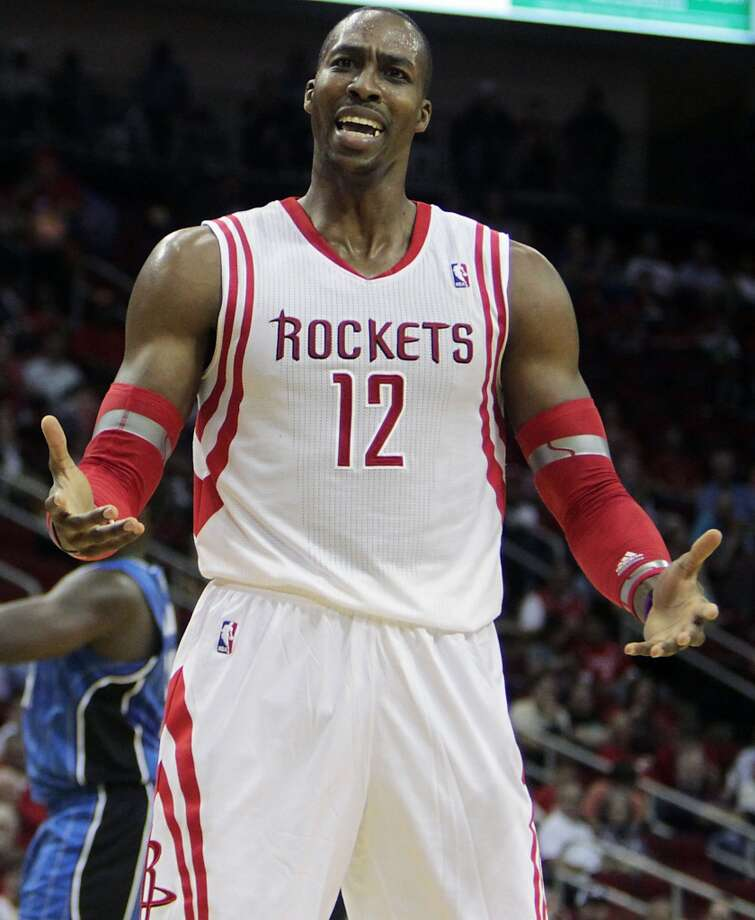 Houston Rockets center Dwight Howard reacts to a call during the second quarter of NBA preseason game action against the Orlando Magic at the Toyota Center Wednesday, Oct. 16, 2013, in Houston.  ( James Nielsen / Houston Chronicle ) Photo: Houston Chronicle