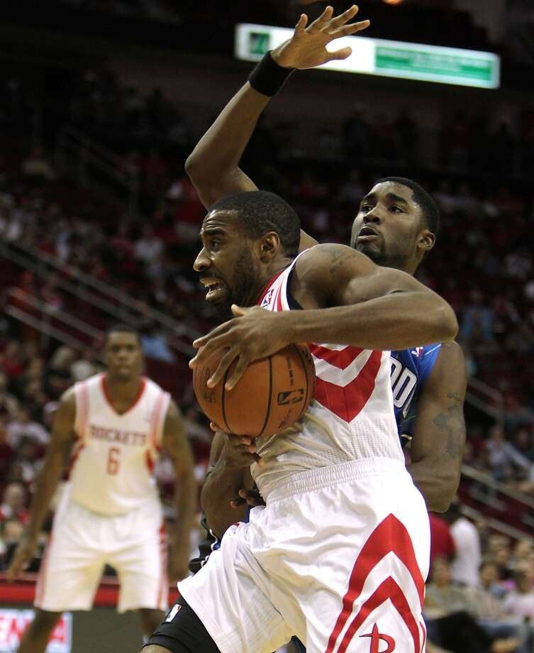 Houston Rockets shooting guard Reggie Williams left, breaks away from Orlando Magic shooting guard E'Twaun Moore right, during the second quarter of NBA preseason game action at the Toyota Center Wednesday, Oct. 16, 2013, in Houston.  ( James Nielsen / Houston Chronicle ) Photo: Houston Chronicle