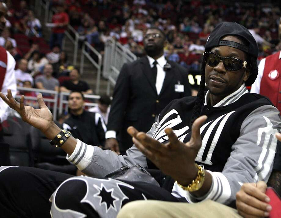 Hip hop recording artist 2 Chainz during first quarter of NBA preseason game action between the Houston Rockets and the Orlando Magic at the Toyota Center Wednesday, Oct. 16, 2013, in Houston.  ( James Nielsen / Houston Chronicle ) Photo: Houston Chronicle
