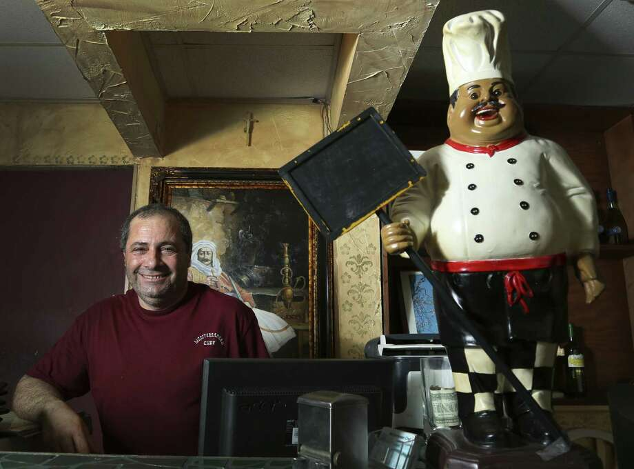 Nidal Ayoub, owner of the Mediter- ranean Chef near the NASA headquarters in Houston, says that workers at the space agency make up about 80 percent of his customer base. Photo: Karen Warren / Houston Chronicle
