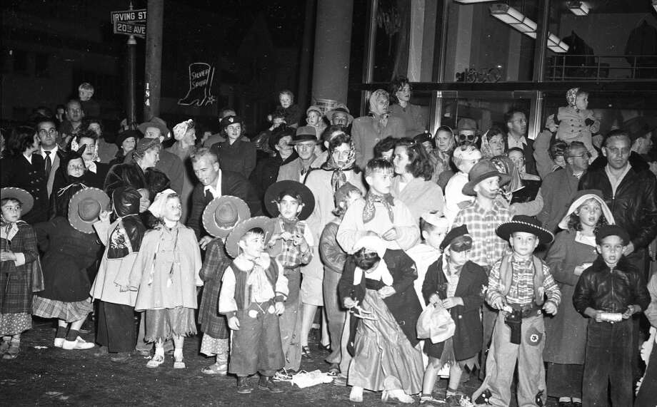 Oct. 31, 1948: Everybody was a cowboy in 1948. Note how few of the parents are dressing up in these photos. Those who did inevitably dressed as witches. It was definitely a holiday for the kids. Photo: Chronicle Staff, The Chronicle