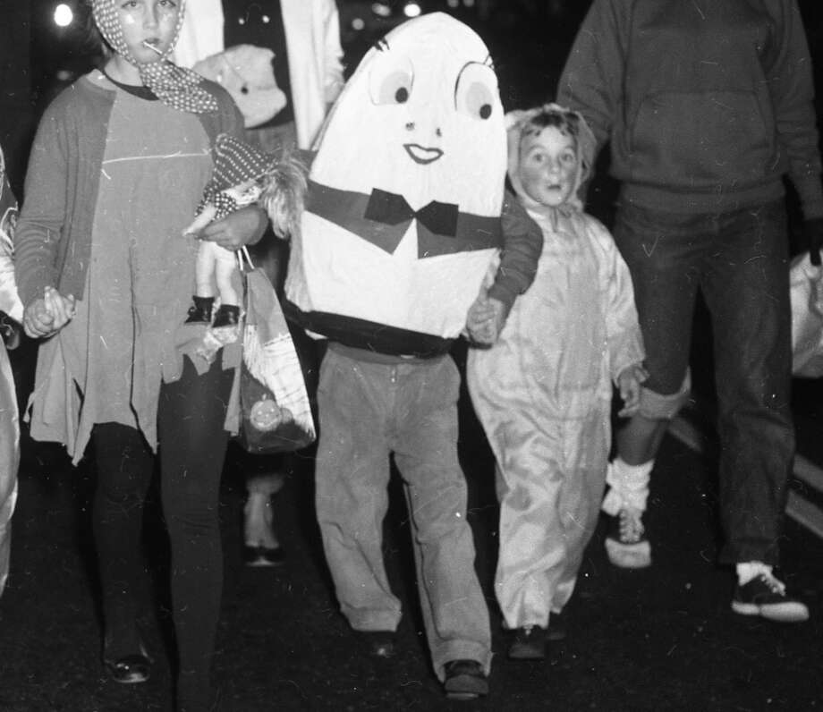 "Dec. 11, 1959: A closer look at Humpty Dumpty costume. Not much visibility in this thing, but at least it was original. Ditto for the girl on the left dressed as a Joad from ""The Grapes of Wrath."" Photo: Chronicle Staff, The Chronicle"