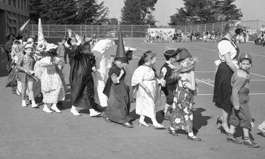 Oct. 31, 1957: The Halloween parade at Twin Peaks School in San Francisco. I like the kid in football gear in the front of the line. There were no replica 49ers jerseys -- or face masks -- in this era. Photo: Art Frisch, The Chronicle