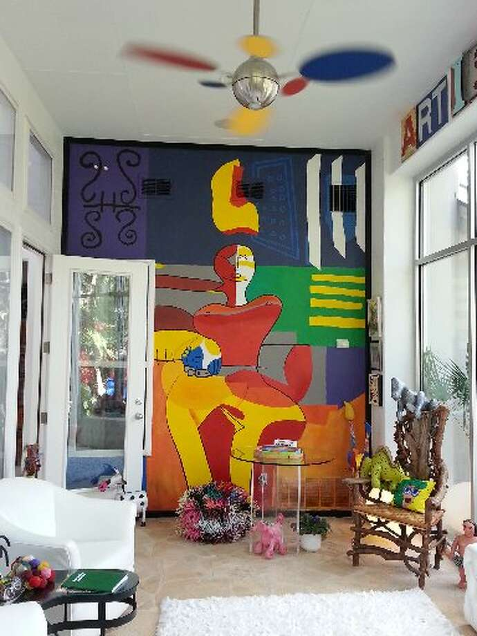On the one solid wall is a mural commissioned from Pablo Veliz when he was a high school student. The image, a Picasso-esque woman sitting, was inspired by a scarf Berkus found in a New Orleans shop. Photo: Emily Spicer, San Antonio Express-News