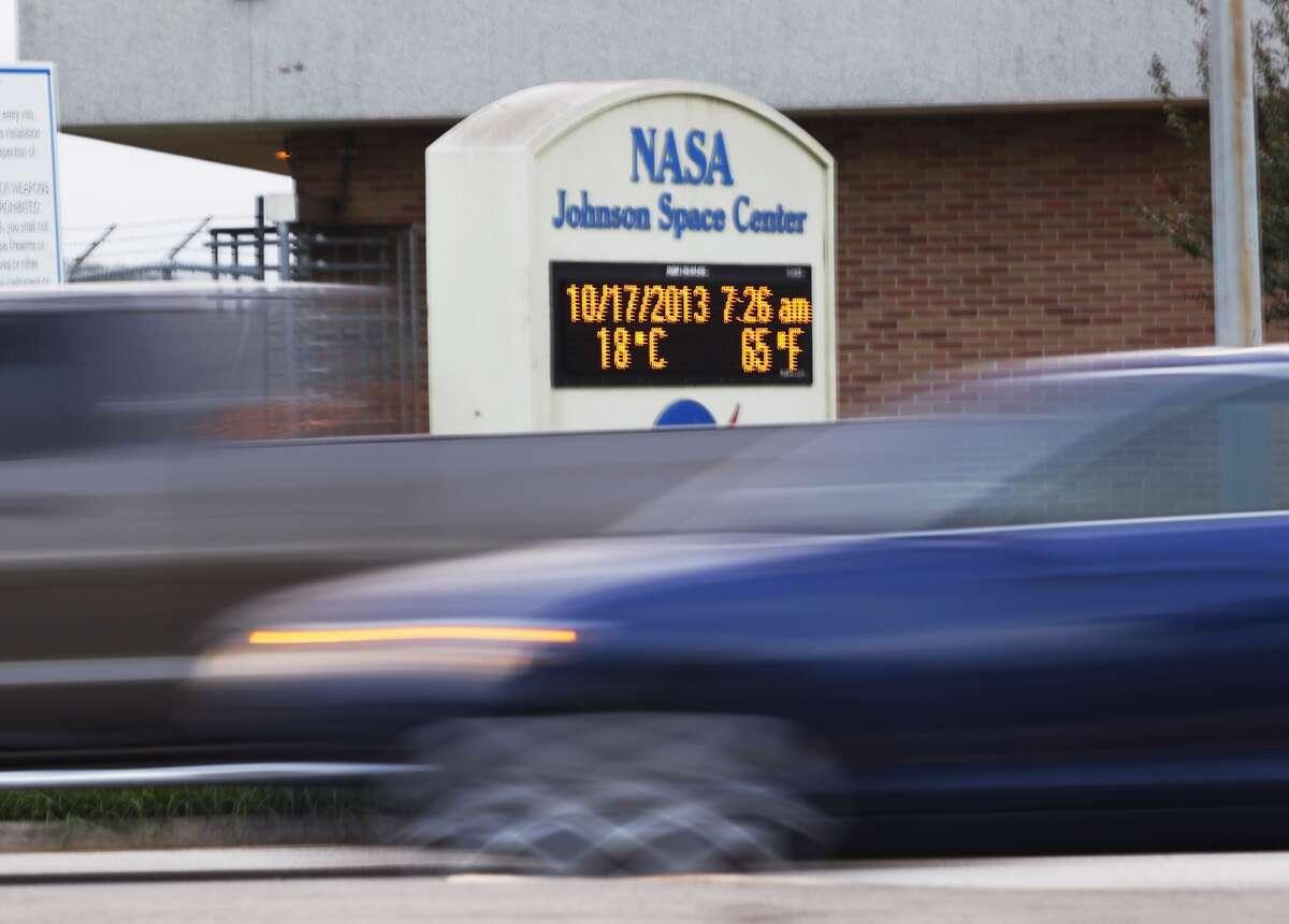 Employees return to work at NASA's Johnson Space Center Thursday morning.