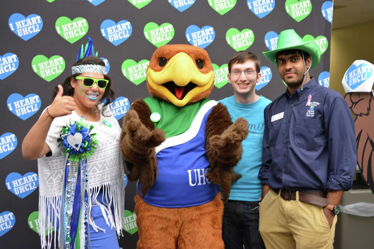 """University of Houston-Clear Lake announced the name of the university's mascot during a special presentation at its annual I HEART UHCL Day event. Pictured with UHCL Hunter the Hawk are members of the university's Student Government Association showing their green and blue school spirit, including SGA President Carla Bradley, SGA Vice President �"""" Committee Coordinator Kenneth Kettler and SGA Vice President �""""Administration Chaitanya Kala."""