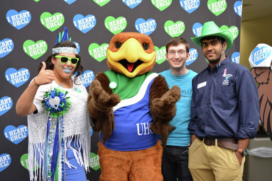 University of Houston-Clear Lake announced the name of the university's mascot during a special presentation at its annual I HEART UHCL Day event. Pictured with UHCL Hunter the Hawk are members of the university's Student Government Association showing their green and blue school spirit, including SGA President Carla Bradley, SGA Vice President – Committee Coordinator Kenneth Kettler and SGA Vice President –Administration Chaitanya Kala.