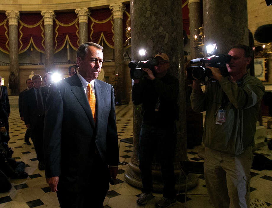 House Speaker John Boehner   walks to the House floor for a vote after the Senate vote. The deal was a near total defeat for conservatives. Photo: Doug Mills, New York Times / NYTNS
