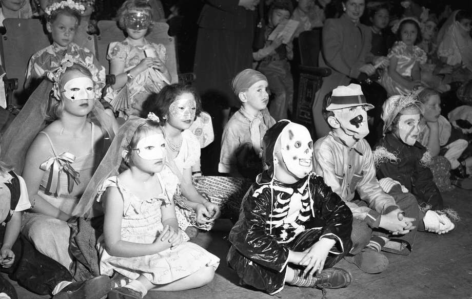 Oct. 28, 1950: From a Halloween party in San Francisco: Several girls in masks, a lazy pirate a skeleton and another early Leatherface costume. Photo: Gordon Peters, The Chronicle