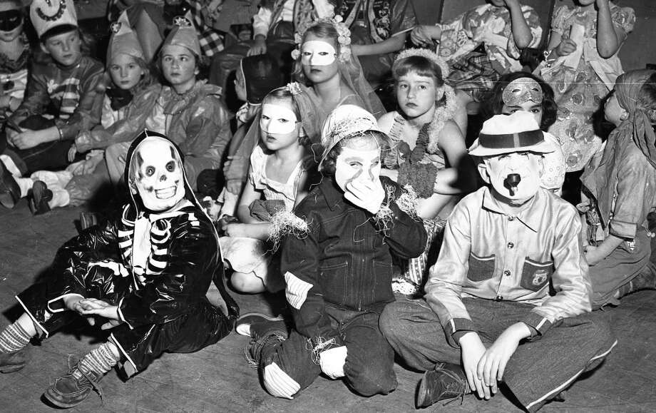Oct. 28, 1950: How do you make a mask that looks like it's been fashioned out of human skin even creepier? Pretend like you're smoking a pipe ... Photo: Gordon Peters, The Chronicle