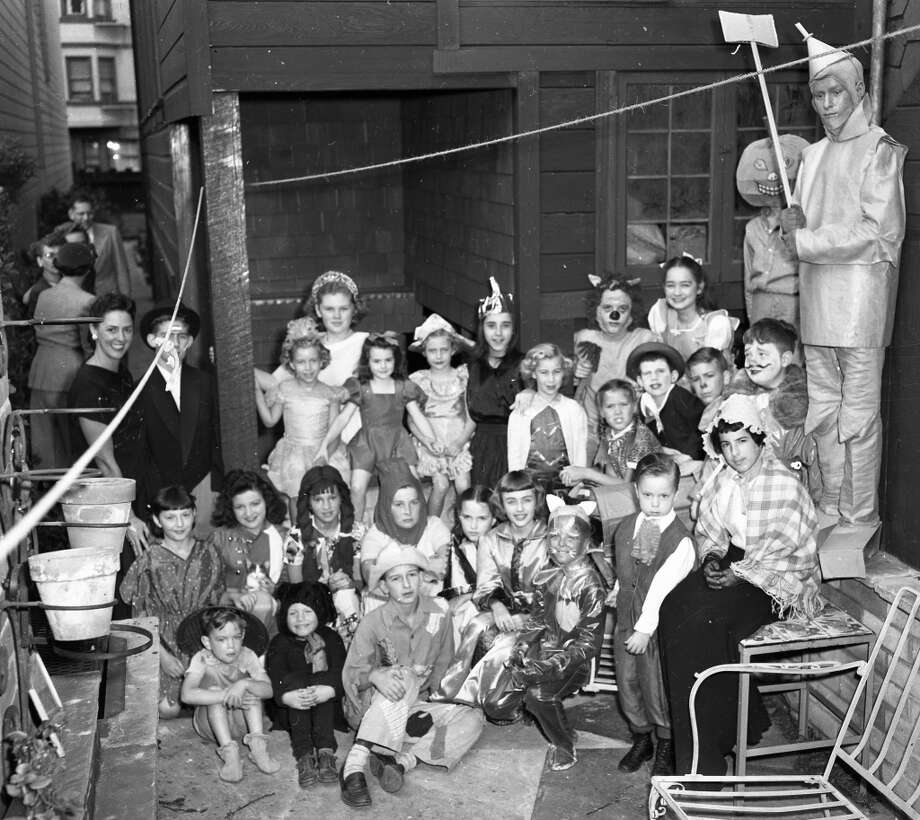 Oct. 28, 1950: There are more children in this photo than exist in all of SF in 2013. I don't trust the Tin Man on the right (is that a real axe?!?), but the parents seem oblivious to his creepiness. Photo: Gordon Peters, The Chronicle