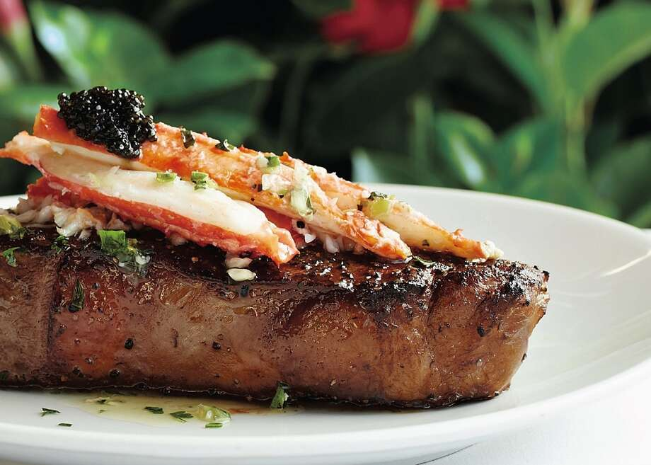 Fleming's new dry-aged steaks can be topped with King crab in herb butter. (Photo: Fleming's)