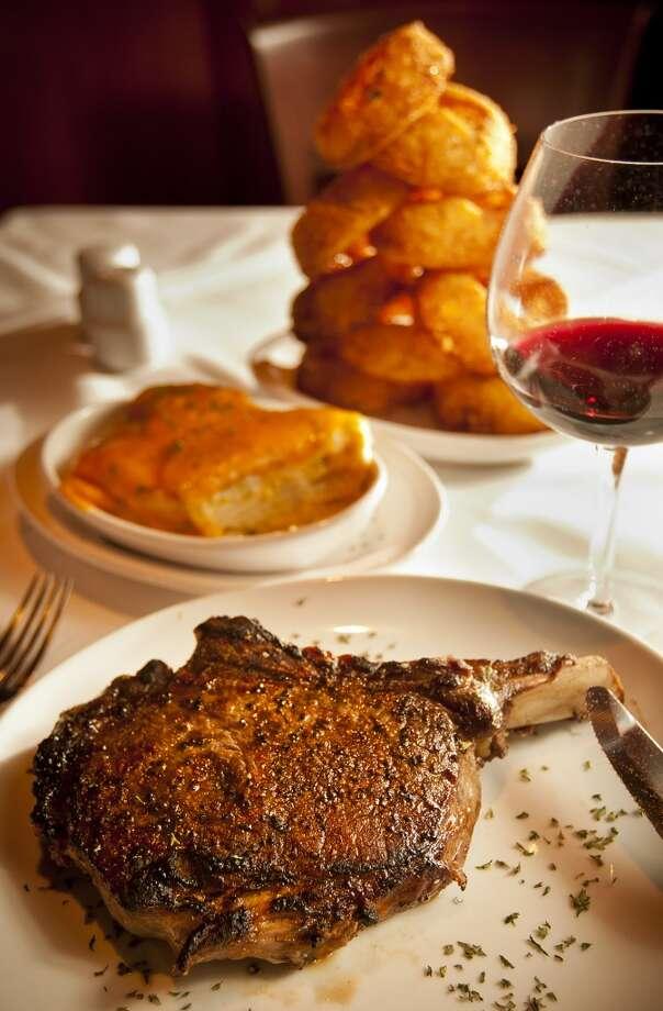 Fleming's Prime Steakhouse & Wine Bar's prime bone in ribeye. (Nick de la Torre / Houston Chronicle ) Photo: Nick De La Torre, Houston Chronicle