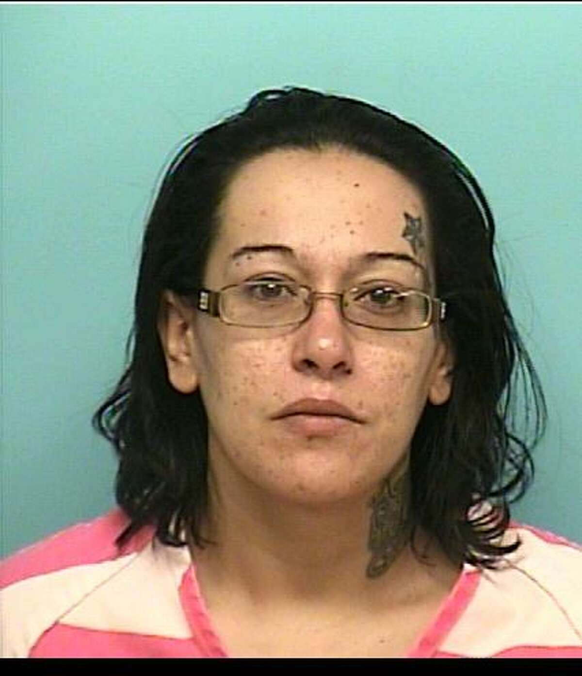 Armandina Reyna, 30, is charged with first-degree felony manufacture/delivery of a controlled substance, third-degree felony possession of a controlled substance and unlawful possession of a firearm by a felon.