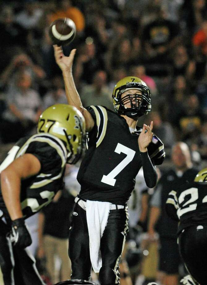 Nederland's Preston White (7) throws a touchdown pass durning the second quarter of Friday night's game at Bulldog Stadium.