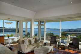 The great room boasts floor-to-ceiling glass windows looking out at the Golden Gate Bridge and Angel Island.