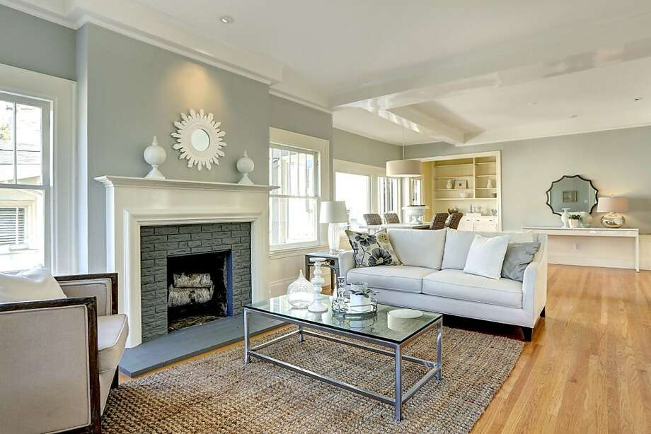 The living room of 38 Portsmouth Road in Piedmont features beamed ceilings, picture windows and a fireplace. Photo: Liz Rusby/The Grubb Co.