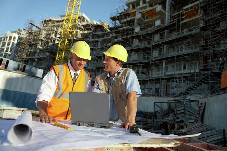 Construction supervisors have to be able to read blueprints, and understand engineering, process controls, concrete structures and more. / (c) Digital Vision.