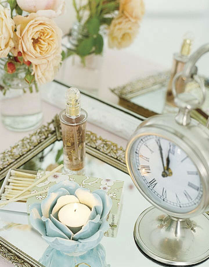 Make a Tray Repurpose mirrors as trays by applying felt backing to their undersides. —Jonathan O'Hea, Jonathan O'Hea Antiques & Design   Reprinted with Permission of Hearst Communications, Inc. Originally Published: 15 Ways to Decorate Your Home — on the Cheap!