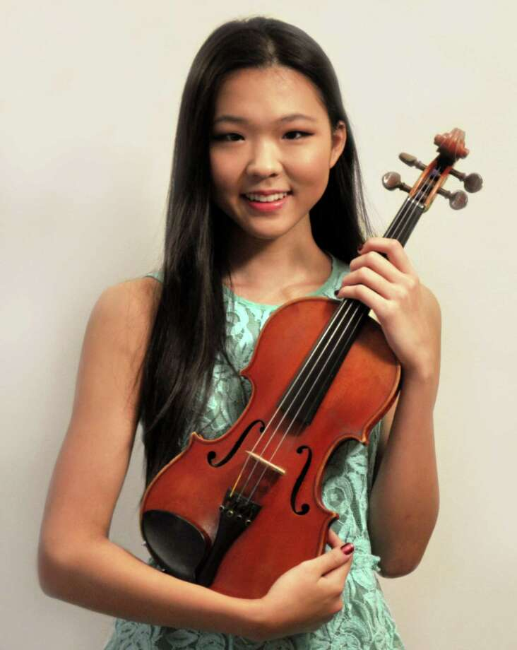 Staples senior violinist Katherine  Zhou has been selected for the first violin section of the 2013 National Association for Music Education AllNational Honor Orchestra. Photo: Contributed Photo / Westport News
