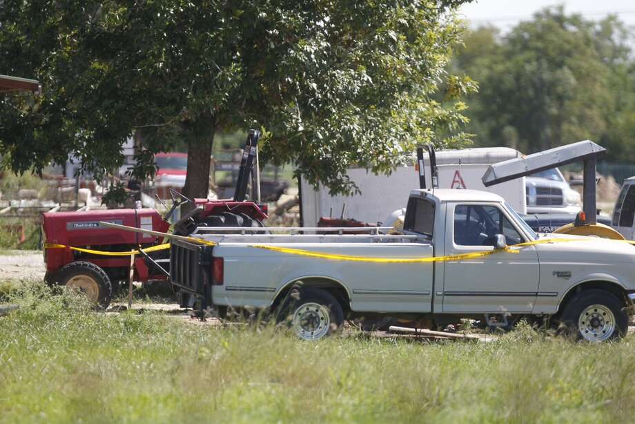 A man was crushed under a truck he was repairing in Katy, Oct. 17, 2013. (Johnny Hanson / Houston Chronicle)