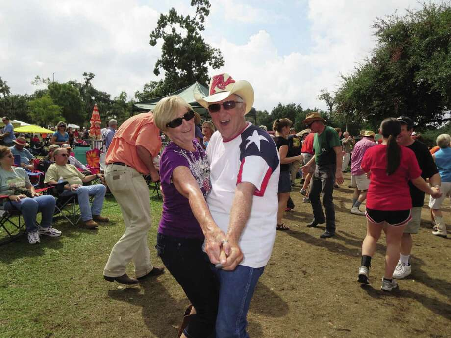San Antonians Chuck and Shari Levert dance the Cajun two-step at Festival Acadiens et Creoles in Lafayette, La. Photo: Wendy Lemlin / For The Express-News