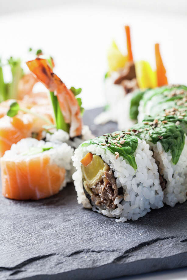 Korean-style roll filled with Prime ribeye, egg omelet, steamed carrots and radish and rolled with rice and spinach. (Photo: Julie Soefer)