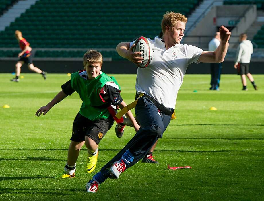 This is called running up the score:Prince Harry outmatches children on the rugby pitch at Twickenham Stadium west of London. The prince, patron of Rugby Football Union All Schools Program, was   teaching the secondary students some of the finer points of the game. Photo: Ian Gavan, AFP/Getty Images