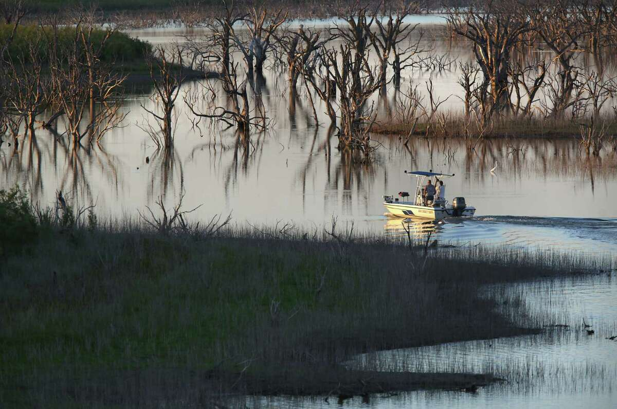 Fishermen head out slowly to avoid tree stumps in the low water on a branch of O.H. Ivie Reservoir at Concho Recreation Area.