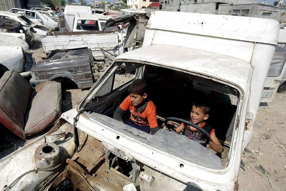Give it more gas:Palestinian boys take a spin in a automobile junk yard in Gaza City during the Muslim Eid al-Adha festival. Photo: Mohammed Abed, AFP/Getty Images