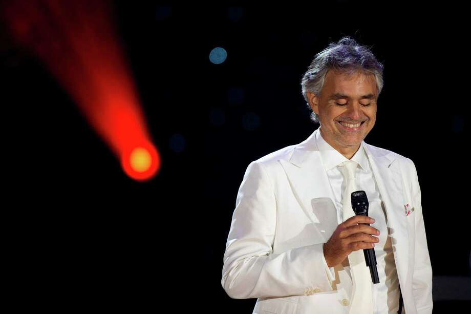 FILE - In this Sept. 16, 2011 file photo, Andrea Bocelli performs a free outdoor concert on Central Park's Great Lawn, in New York. The 55-year-old tenor says he'll receive a master's degree in vocal performance from The Conservatory of Music, Giacomo Puccini in La Spezia, Italy, on Tuesday, Oct. 22, 2013. (AP Photo/Charles Sykes, File) ORG XMIT: CAET157 Photo: Charles Sykes / FR170266 AP