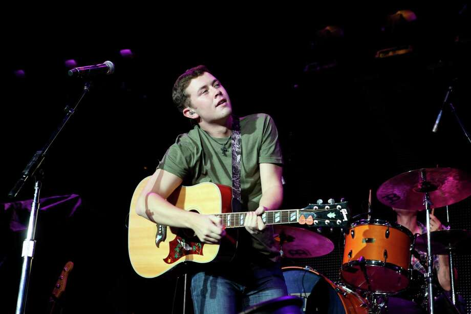 "FILE - In this Sept. 15, 2012 file photo, Scotty McCreery performs at Aarons Amphitheater in Atlanta. McCreery rode a wave of success after winning the 2011 season of ""American Idol,"" with his first record going platinum and winning several new artist awards. But with his sophomore album, ""See You Tonight,"" McCreery says his career is now in his hands alone. (Photo by Robb Cohen/RobbsPhotos/Invision/AP, File) ORG XMIT: CAET143 Photo: Robb Cohen / Invision"