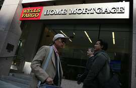 SAN FRANCISCO, CA - OCTOBER 11:  Pedestrians walk by a Wells Fargo home mortgage office on October 11, 2013 in San Francisco, California. Wells Fargo reported a 13 percent increase in third-quarter profits with a net income of $5.6 billion, or 99 cents a share compared to $4.9 billion, or 88 cents a share one year ago.  (Photo by Justin Sullivan/Getty Images)