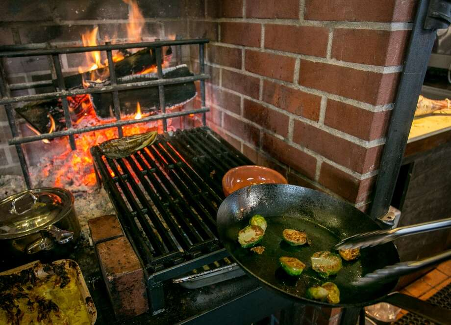 Brussels Sprouts being cooked over the wood fire at Homestead in Oakland. Photo: John Storey, Special To The Chronicle