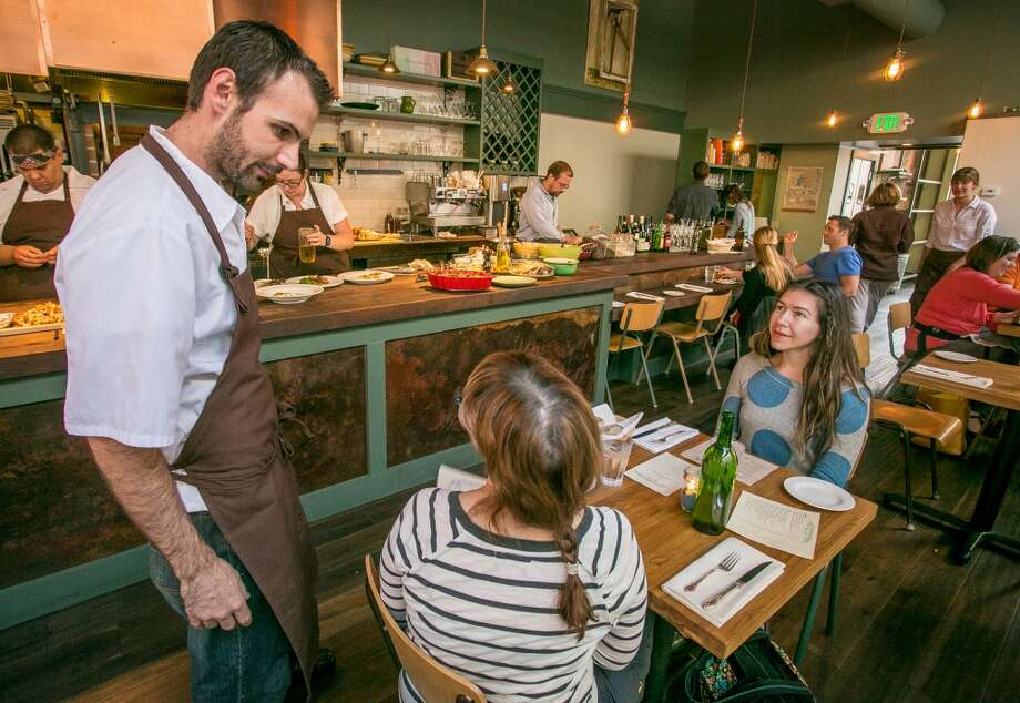Chef Fred Sassen talks with customers during dinner at Homestead in Oakland. Photo: John Storey, Special To The Chronicle