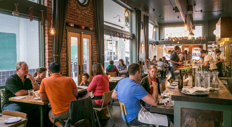 People enjoy dinner at Homestead in Oakland. Photo: John Storey, Special To The Chronicle