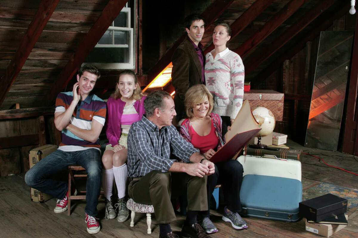 """Three different stages in the lives of Sue and Dan are examined in the new musical """"Snapshots"""" at the Norma Terris Theatre in Chester, starting Thursday, Oct. 24. The cast includes (standing, left to right) Matthew Scott, Elizabeth Stanley, (seated) Dan Deluca, Ephie Aardema, Mark Jacoby and Karen Mason."""