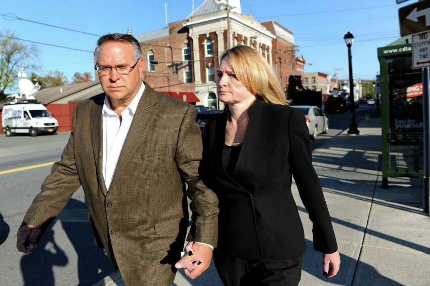Melinda A. Wormuth, Halfmoon Town Supervisor, right, leaves Waterford Town Court with her husband, Larry Wormuth, following her arraignment on Wednesday, Oct. 17, 2013, in Waterford, N.Y. (Cindy Schultz / Times Union)