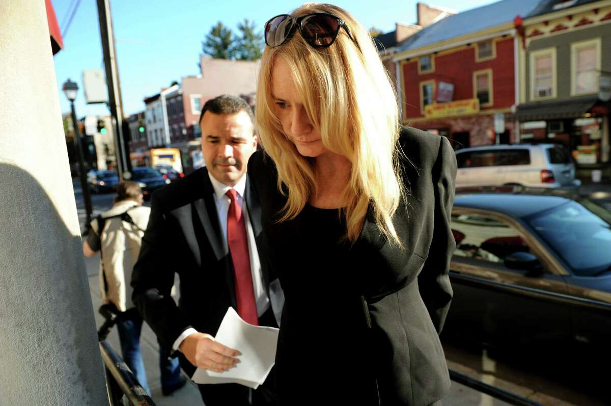 Melinda A. Wormuth, Halfmoon Town Supervisor, right, arrives for arraignment on Wednesday, Oct. 17, 2013, at Waterford Town Court in Waterford, N.Y. (Cindy Schultz / Times Union)