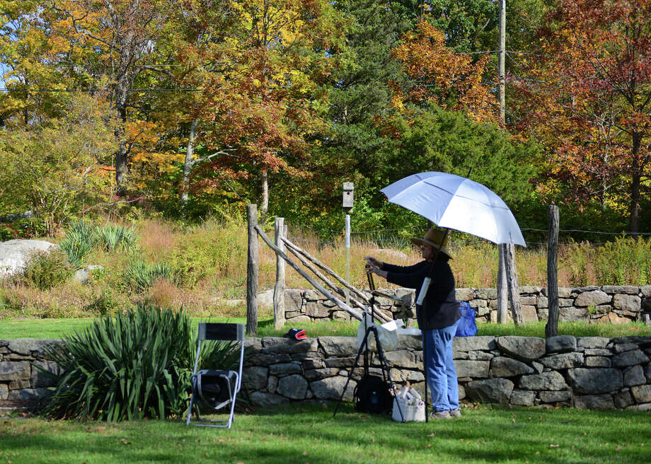 Donna Favreau, of Bethel, paints a picture at Weir Farm National Historic Site in Wilton, Conn. on Thursday, Oct. 17, 2013.  The government-operated park re-opened Thursday with the end of the government shutdown.  Employees and volunteers restored the property after more than two weeks off, allowing visitors to come back and enjoy the park. Photo: Tyler Sizemore / The News-Times